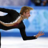 Russia's Yevgeny Plushenko skates toward a 2nd-place finish in the men's short program at the Iceberg Skating Palace Thursday. | APF-JIJI