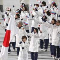 Members of Japan's Olympic team wave to the audience at the Fisht Olympic Stadium during the opening ceremony of the Sochi Winter Olympics. | KYODO