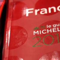 Copies of the new 2014 annual Michelin restaurant guide are presented Monday during the announcement of the newly promoted chefs in Paris. | REUTERS