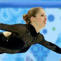 Italy's Carolina Kostner performs her free skate in the women's figure skating event on Thursday. Kostner earned the bronze for her first medal in her third Olympic appearance and first ever medal for Italy in the sport. | AFP-JIJI