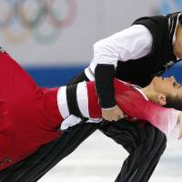 Chris and Cathy Reed represent Japan in the ice dance portion of the team figure skating competition at  the Sochi Winter Olympics. | AFP-JIJI