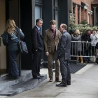 A staff member (left) from the medical examiners office enters the building containing the home of actor Philip Seymour Hoffman Feb. 2, in New York. Hoffman was found dead in his Greenwich village apartment Sunday.  | AP