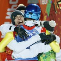 Germany's Andreas Wank (left) celebrates with his teammates after winning the gold in the ski jumping large hill team event at the 2014 Winter Olympics on Monday in Krasnaya Polyana, Russia.  | AP