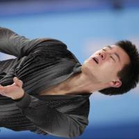 Canada's Patrick Chan performs his short program on Thursday. Chan scored 97.52 points and is in second place. | AP