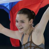 Sotnikova stuns Kim to win Olympic gold in Sochi
