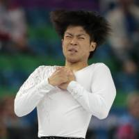 Tatsuki Machida performs his short program on Thursday. He is in 11th place with 83.48 points. | AP