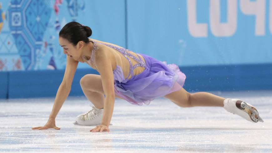 Mao Asada of Japan falls after attempting a triple axel in her short program on Wednesday. She posted 55.51 and is in 16th place. | AP