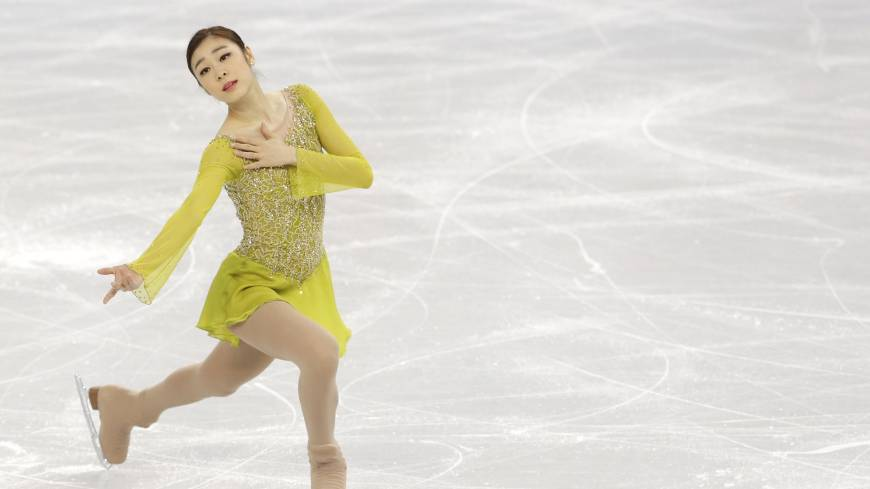 Defending champion Yuna Kim of South Korea competes in the women's figure skating short program event at the Iceberg Skating Palace during the 2014 Winter Olympics on Wednesday in Sochi, Russia. Kim posted 74.92 and is in first place. | AP