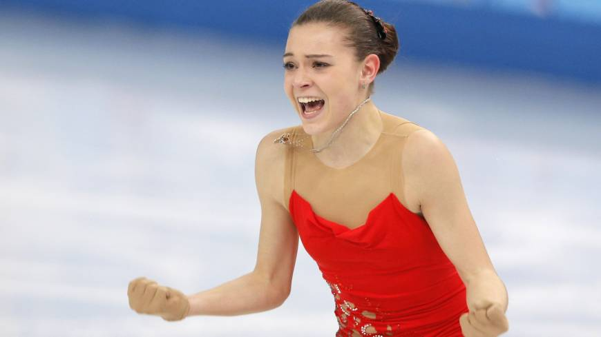 Adelina Sotnikova of Russia reacts after completing her short program in the women's figure skating competition on Wednesday. She earned 74.64 points and stands in second place behind Kim heading into Thursday's free skate. | AP