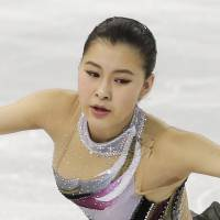 Kanako Murakami of Japan competes in the women's short program figure skating competition at the Iceberg Skating Palace during the 2014 Winter Olympics, Wednesday, Feb. 19, 2014, in Sochi, Russia. | AP