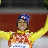 Noriaki Kasai celebrates winning the silver medal Saturday after the ski jumping large hill final at the 2014 Winter Olympics in Krasnaya Polyana, Russia. | AP