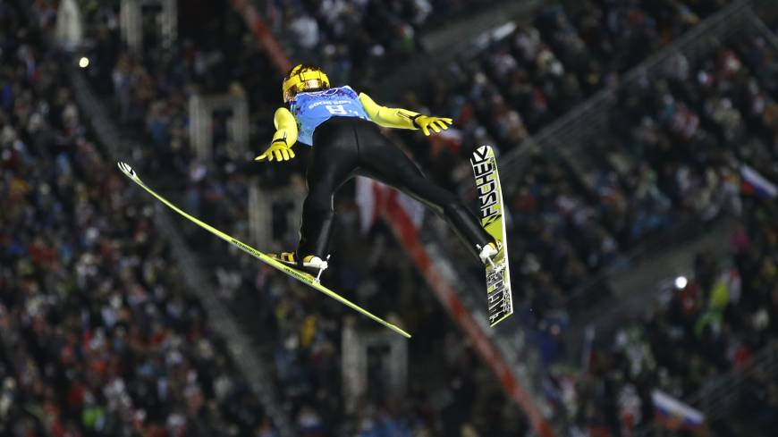 Japan's Noriaki Kasai makes an attempt during the ski jumping large hill team event at the 2014 Winter Olympics on Monday in Krasnaya Polyana, Russia.