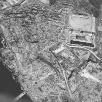 Never again: An aerial view shows the devastation wrought by the atomic bomb dropped on Nagasaki on Aug. 9, 1945, in a picture supplied by the Daily News company.  The attack by U.S. forces came three days after a similar device was dropped on Hiroshima. Estimates of the death toll from the bombings and their aftereffects range between 150,000 and 250,000. | KYODO