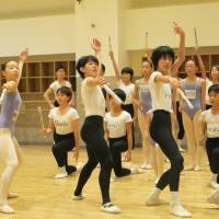 Best feet forward: K-Ballet School pupils practice swordfighting, listen intently and strike classic poses during a rehearsal for ABT's 'The Nutcracker.'   NOBUKO TANAKA