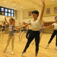 Best feet forward: K-Ballet School pupils practice swordfighting, listen intently and strike classic poses during a rehearsal for ABT's 'The Nutcracker.' | NOBUKO TANAKA