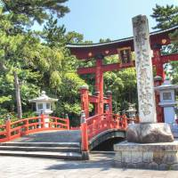 Grand entrance: The vermillion torii at Kehi Jingu was last rebuilt in 1645, and is one of the three greatest wooden shrine gates in Japan. | ALON ADIKA PHOTO