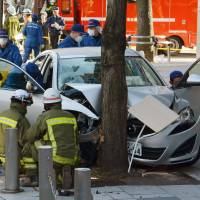 A car allegedly used to run over 13 pedestrians Sunday waits to be towed near Nagoya Station. | KYODO