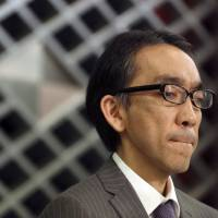 Out of the shadows: Takashi Niigaki, ghostwriter of well known deaf composer Mamoru Samuragochi, reacts to a reporter's question during a news conference in Tokyo Thursday. Niigaki said he hopes to continue composing and performing, despite the uproar over Samuragochi's admission Wednesday that he did not write the pieces he is best known for, such as his 'Hiroshima Symphony.' | AP