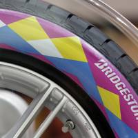 Caught out: A tire bears the Bridgestone Corp. logo on the second day of the Paris Motor Show on Sept. 28, 2012. | BLOOMBERG