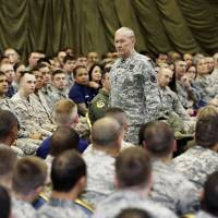 Briefing: U.S. Joint Chiefs Chairman Gen. Martin Dempsey speaks to U.S. service members last April at Yokota Air Base outside Tokyo. A probe into the military's handling of sexual assaults in Japan has found a pattern of random, inconsistent judgments and few incarcerations. | AP