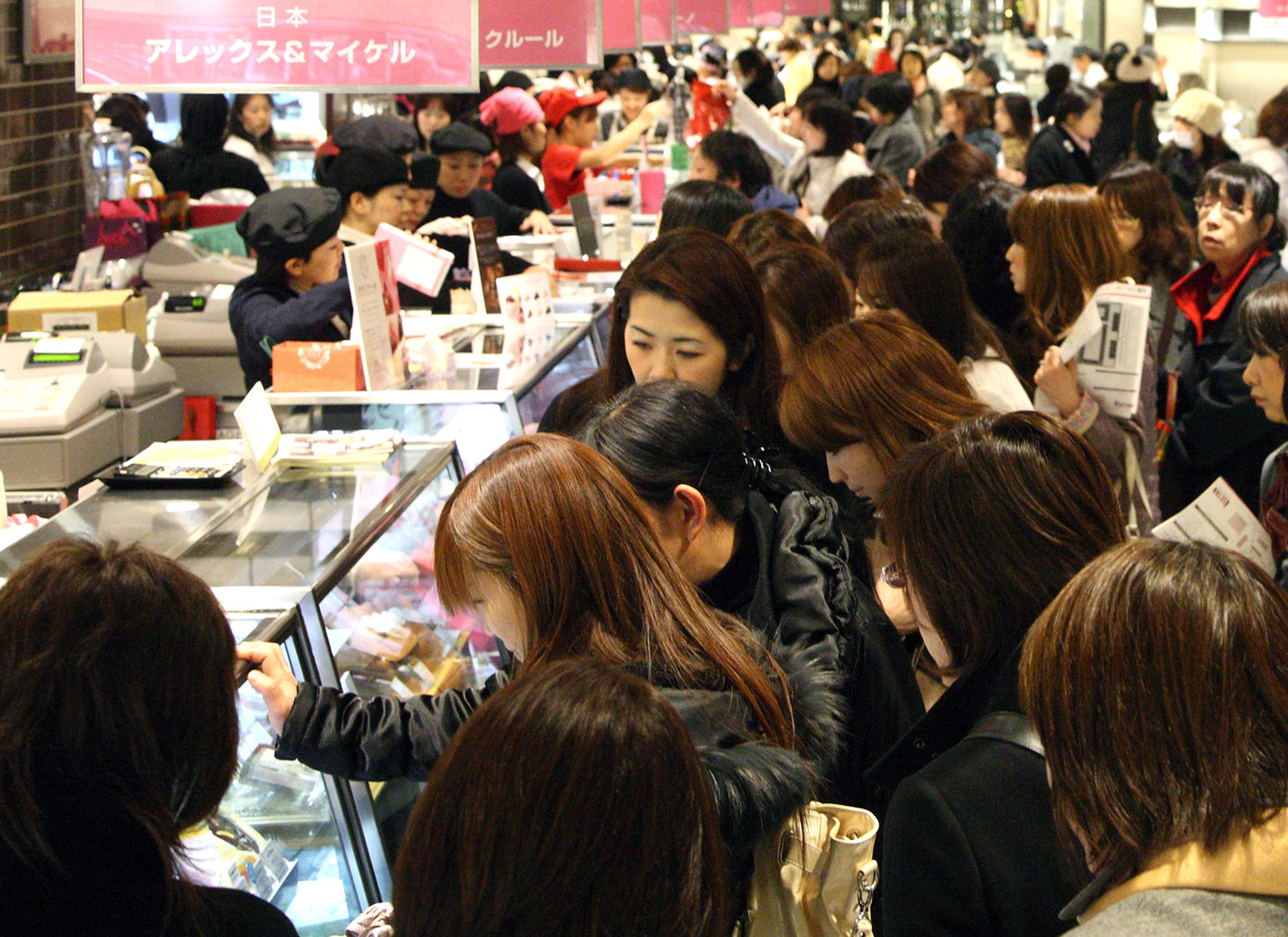 Obligated: Female customers shop for chocolates ahead of Valentine's Day. Japan differs from many countries that celebrate the occasion in that it is women who offer men gifts and not the other way around. | BLOOMBERG