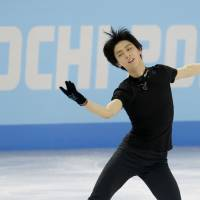 Team player: Yuzuru Hanyu practices at the Iceberg Skating Palace in Sochi, Russia on Wednesday. | AP