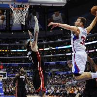 Heat put brakes on Clippers' rally in fourth