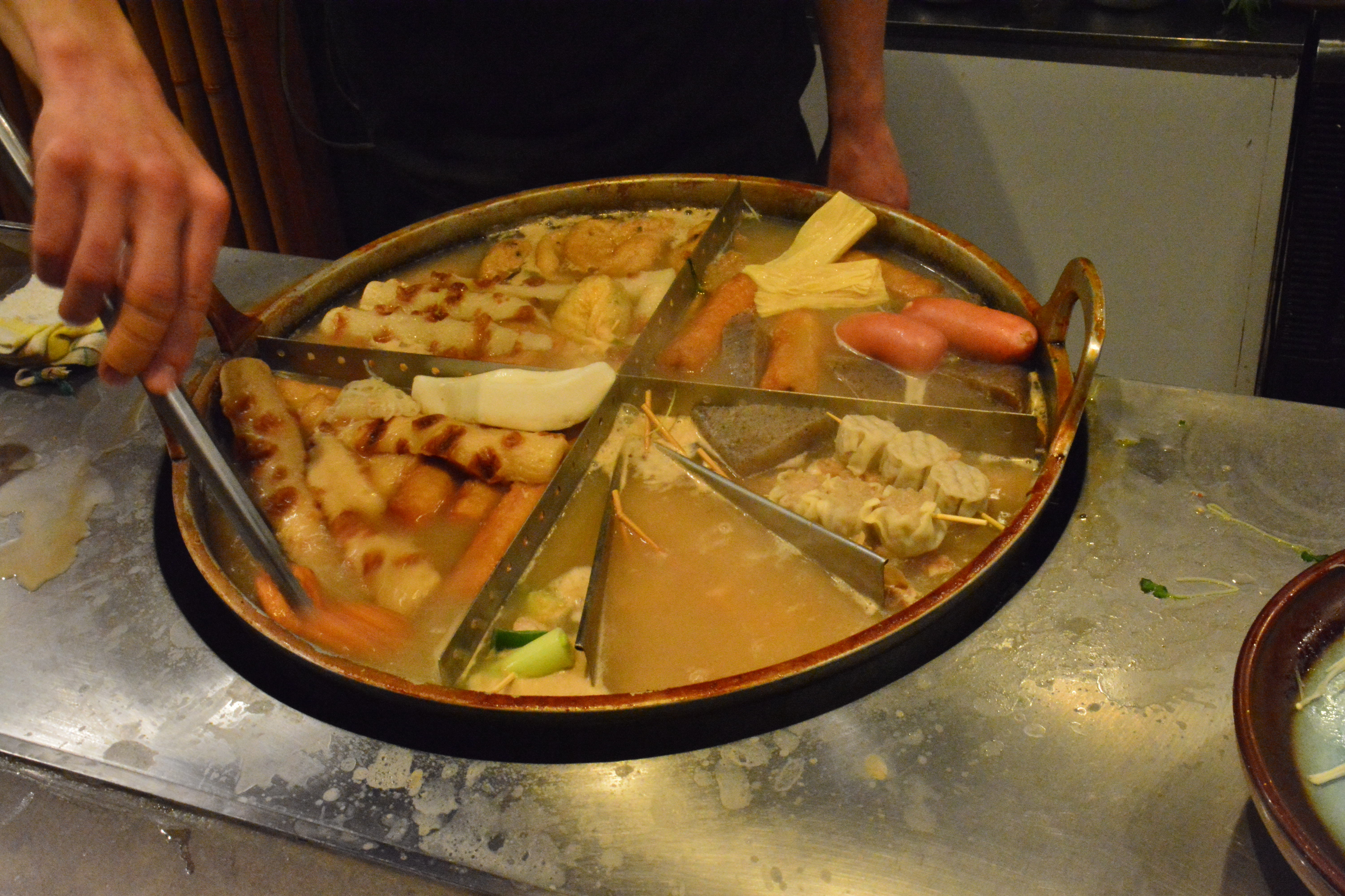 Winter's cauldron: The master at Hanakujira tends selections of oden, a year-round dish similar to stew that is best served with cold weather. | JJ O'DONOGHUE