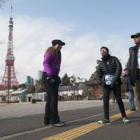 Endurance: Melamed passes Tokyo Tower with the Proyecto Vamos team on his run last Sunday. | NATALIE HOWARD
