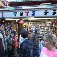 Location, location, location: Toys Terao is one of about 80 tiny shops lining the 250-meter shopping street that starts inside Sensoji's great red Kaminarimon entrance gate and ends just short of the grander Hozomon gate. | MICHAEL KLEINDL