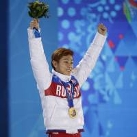 Don't look back: Russia's Victor Ahn celebrates on the podium after winning gold in the 1,000-meter short track race. | AP