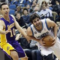Lone wolf: Minnesota's Ricky Rubio (right) tries to break away from Los Angeles' Steve Nash during the Timberwolves' 109-99 win at the Target Center in Minneapolis on Tuesday. | AP