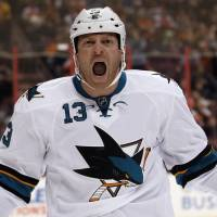 Primal scream: San Jose's Raffi Torres celebrates after scoring in the Sharks' 7-3 win over the Flyers on Thursday. | AP