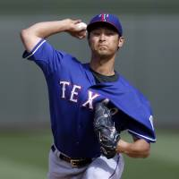 Royal flush: Texas' Yu Darvish delivers a pitch against the Royals on Thursday.   AP
