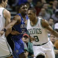 I got this: Celtics guard Rajon Rondo dribbles as teammate Kris Humphries sets a screen on the Magic's E'Twaun Moore on Sunday in Boston. The Celtics won 96-89. | AP