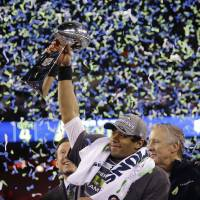 Just getting started: Seahawks quarterback Russell Wilson became a Super Bowl champion in just his second season in the NFL. | AP
