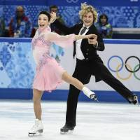 Perfect harmony: Meryl Davis and Charlie White perform their short dance at the Iceberg Skating Palace on Sunday. | AP