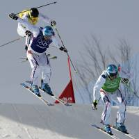 Three Musketeers: France's Jean Frederic Chapuis (right) Arnaud Bovolenta (middle) and Jonathan Midol race in the skicross event on Thursday at the Sochi Olympics. | AFP-JIJI