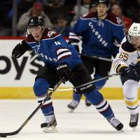 No mercy: Colorado's Nick Holden reaches for the puck as Buffalo's Brian Flynn chases during the Avalanche's 7-1 victory. | AP