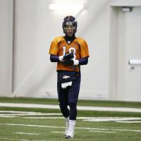 Five star: Peyton Manning enters the practice field at Florham Park, New Jersey, on Saturday ahead of Super Bowl XLVIII.   AP