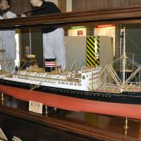 A scale model of the Hikawamaru luxury liner, recently returned to major shipping company NYK Line from the United States, is displayed at the firm's museum in Yokohama on Tuesday. | KYODO