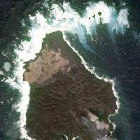A new volcanic islet in the Pacific Ocean is shown after merging with Nishinoshima Island, part of the Ogasawara chain, in this image taken by the Geospatial Information Authority of Japan on Feb. 16.   KYODO