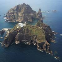 The disputed Takeshima islets, held by South Korea, which calls them Dokdo, lie midway between Japan and the South. Shimane Prefecture plans to hold its annual Takeshima Day on Saturday. | KYODO