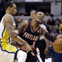 In the mood: Indiana's George Hill (left) stops Portland's Damian Lillard during the Pacers' 118-113 win on Friday. | AP