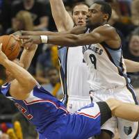 Stifling defense: Grizzlies guard Tony Allen (9) and center Kosta Koufos block Clippers forward Blake Griffin's shot in the second half on Friday. | AP