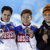 Where I belong: Viktor Ahn (center) will leave the games with four medals after winning gold in the 500 meters and 5,000-meter relay Friday. | AP