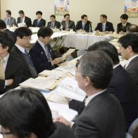 Members of the Liberal Democratic Party's committee on education discuss reforming the board of education system at the party's headquarters in Tokyo on Feb. 19. | KYODO
