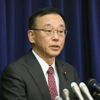 Justice Minister Sadakazu Tanigaki faces reporters on Dec. 12 to announce the hanging of two death-row inmates.  | KYODO