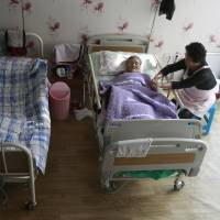 Former sex slave Kim Jong-boon, 85, receives care at the House of Sharing.   AP
