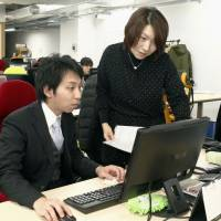 Masako Tanaka (right) confers with Takayuki Inoshita, president of Whiteplus Inc., at their office in Shibuya Ward, Tokyo, on Jan. 22. | KYODO